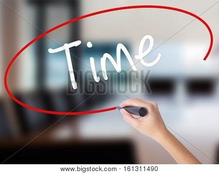 Woman Hand Writing Time With A Marker Over Transparent Board