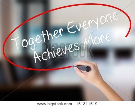 Woman Hand Writing Together Everyone Achieves More With A Marker Over Transparent Board