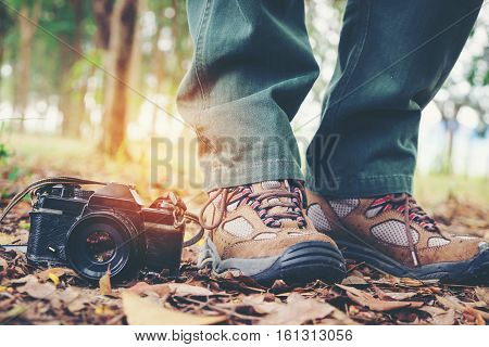 Feet Traveler Man And Retro Photo Camera Outdoor Travel Lifestyle Vacations And Travel Concept Vinta