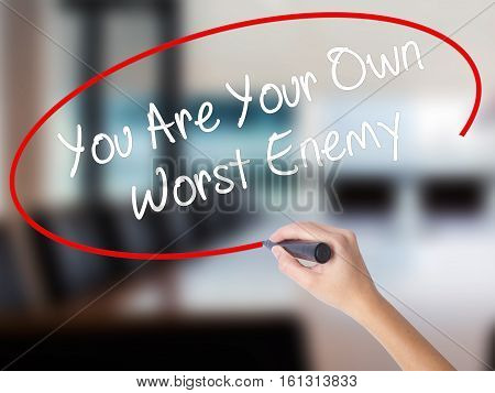 Woman Hand Writing You Are Your Own Worst Enemy With A Marker Over Transparent Board