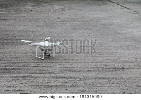 white drone with high resolution digital camera on the cement floor
