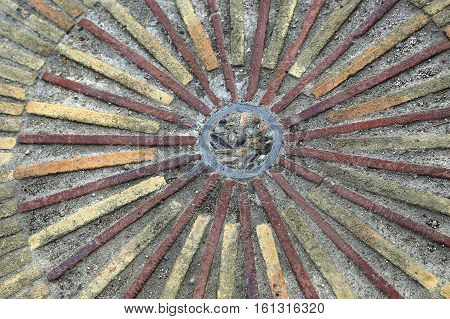 Pavement with granite strips concentric pattern. Patterned floor walkway in the park Montjuic Barcelona Spain