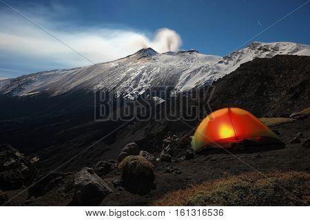lighting tent on moonlight winter Etna Park, Sicily