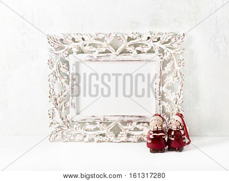 Vintage picture frame with vintage Christmas decorations