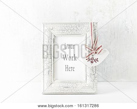 Shabby chic image frame with a vintage decoration
