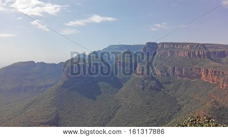 The Three Rondavels in the Blyde River Canyon in South Africa, powerful rock formations from red sandstone, which is similar to the round huts of the native ones