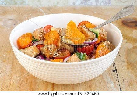Healthy Salad Bowl With Cuscus, Tomatoes, Cucumber, Chicken, Tangerine And Sesame Seeds
