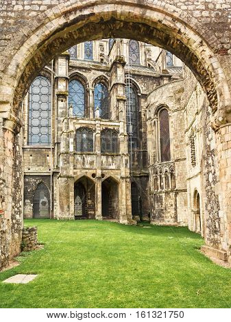 Looking through the arch into the Cloister at Canterbury Cathedral. Kent UK