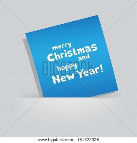 The colored blue piece of paper with the message of Christmas greetings on gray pocket