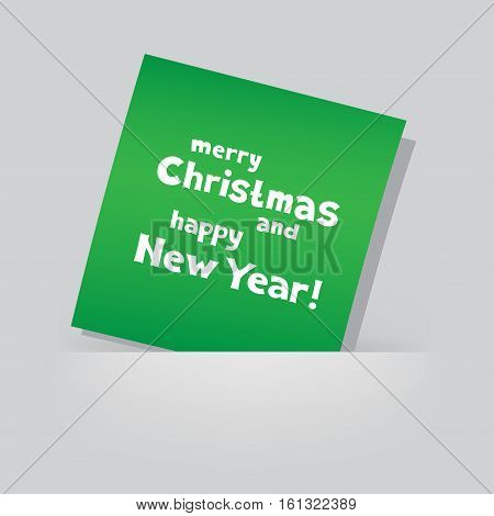 The colored green piece of paper with the message of Christmas greetings on gray pocket