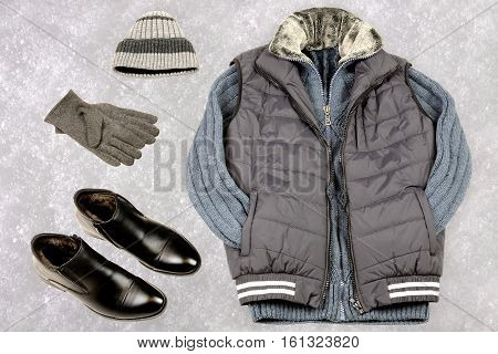 Men's winter clothing on the background of snow. Warm clothes in winter