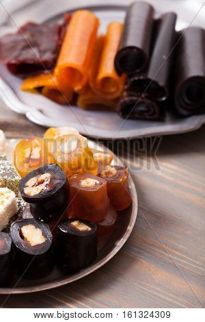 Various types of dry fruit leather with nuts close up
