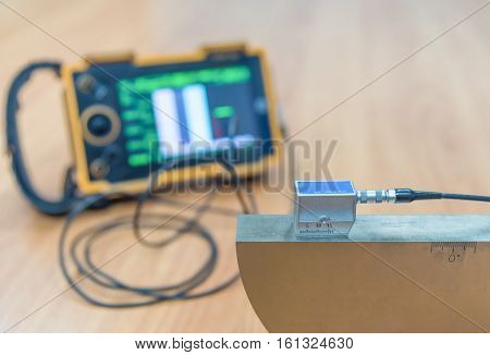 Ultrasonic Test Calibration by angle beam probe with standard block.