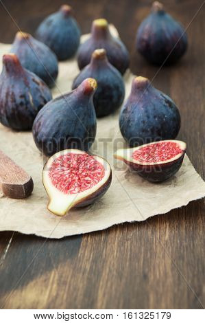 Fresh figs fruits on rustic background. Pile of ripe figs selective focus vertical