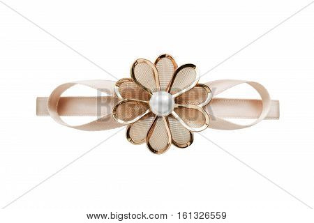 Golden flower shaped barrette isolated over white