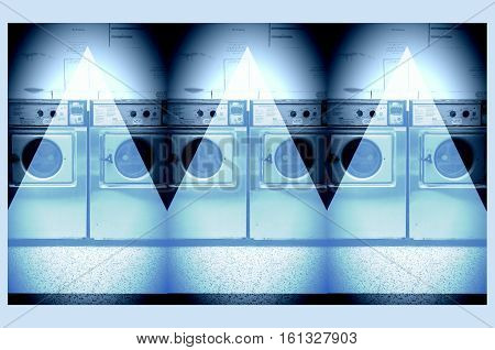 Laundrette interior with row of laundry washing machines
