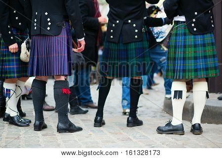 Men in traditional kilts, closeup of legs