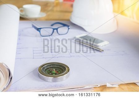 safety helmet blue print plan on engineer working table. land development theme