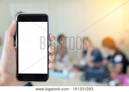 man using smart phone with blank mobile. Smart phone with blank screen and can be add your texts or others on smart phone. at meeting room