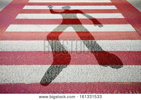 Silhouette of man drawn on a red and white paved road - concept image