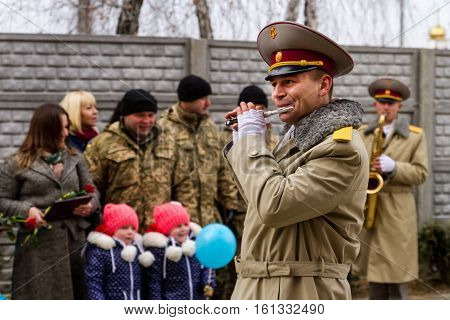 Chop Ukraine - December 6 2016: Military Band performs during the distribution to servicemen of the Armed Forces of Ukraine of new flats. On this day in Chop 23rd soldiers who served in the ATO it was handed the keys to new apartments.