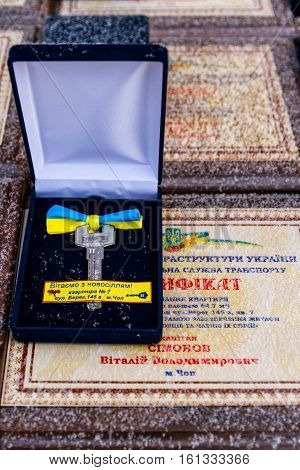 Chop Ukraine - December 6 2016: Keys from new apartments and certificates on the table during the ceremony of receiving new apartments of the Armed Forces of Ukraine who served in the ATO. On this day in Chop 23rd soldiers was handed the keys to new apart