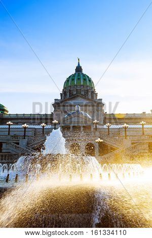 Pennsylvania Capital Building In Harrisburg. Back Side Of The  With The Fountain In The Foreground.