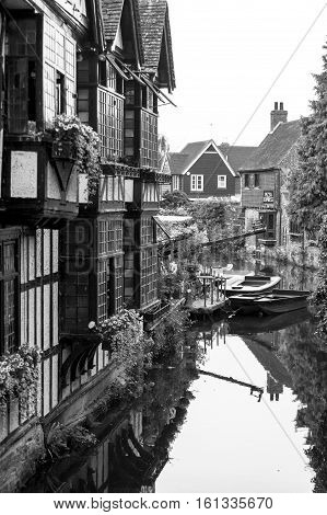 Canterbury, Kent, United Kingdom - June 16, 2006: The Old Weavers House on the left bank dates from 1500 and is built on the River Stour which is very narrow at this point. The river is flanked on the right by ancient half-timbered houses. Canterbury Kent