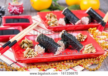 Seaweed nori on the plate on a wooden background