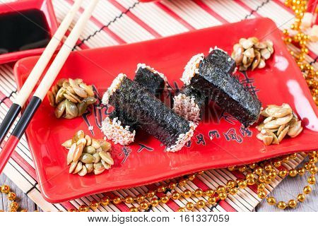 snack nori on the plate on a wooden background