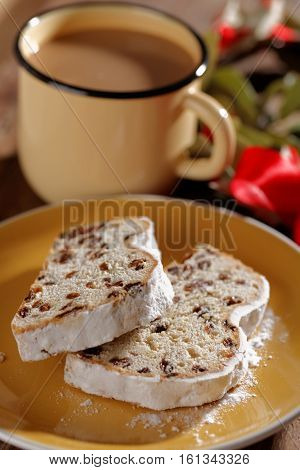 Slices of Christstollen on a Christmas table