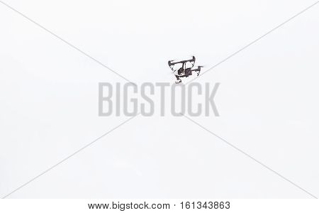 Aerial drone flying high in the sky on a bright sunny day capturing aerial footage and aerial images.