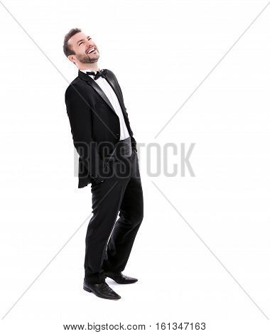 Confident Successful Smart Looking Man Laughing wearing black tuxedo isolated on white background space for text