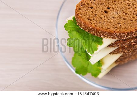 Bread with cheese and parsley on the table.