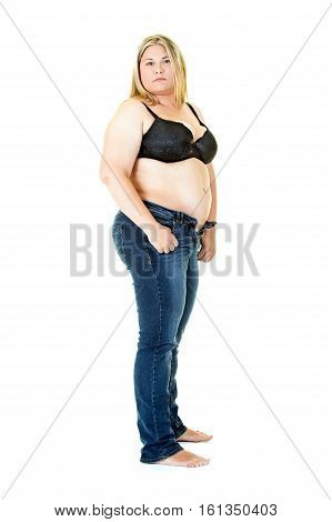 Overweight Young Woman In Bra And Jeans On White