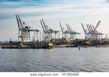 Hamburg, Germany - November 01, 2015: Large diggers stand by for excavating the Elbe channel to allow bigger ships ente the harbor.