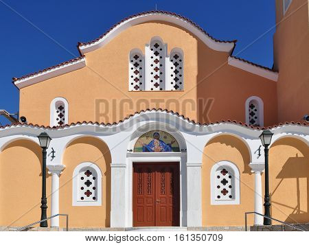 Facade of typical Greek house built in Venetian style in Assos town, Kefalonia island, Greece