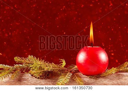 Christmas celebration candle burning on gray wood