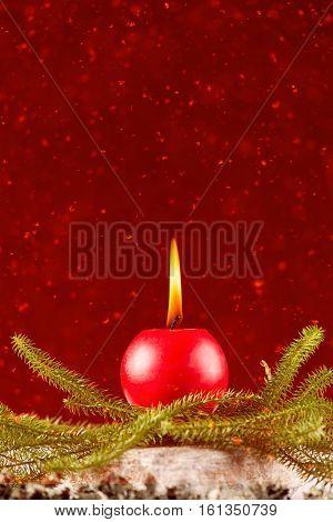 Christmas celebration candle burning on gray wood