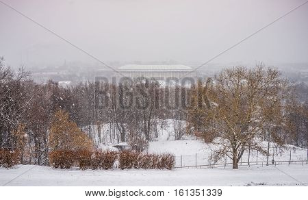 View from the Sparrow Hills in Moscow at the Luzhniki Stadium in winter snowfall