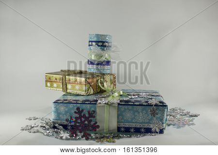 Christmas gift boxes with ribbons on a white background