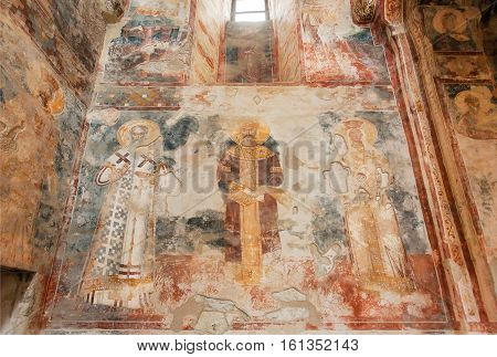 KUTAISI, GEORGIA - SEP 22, 2016: Figures of the historical Saints on fresco of medieval monastic complex Gelati on September 22, 2016. Gelati monastery was built in 12th century UNESCO World Heritage Site.