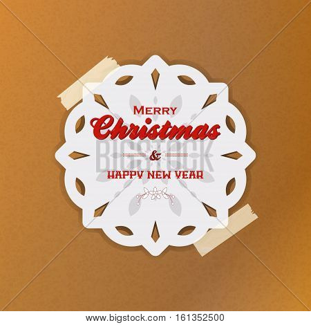 White Snowflake with Marry Christmas and Happy New Year Text Hanging with tape Over Brown Paper Background