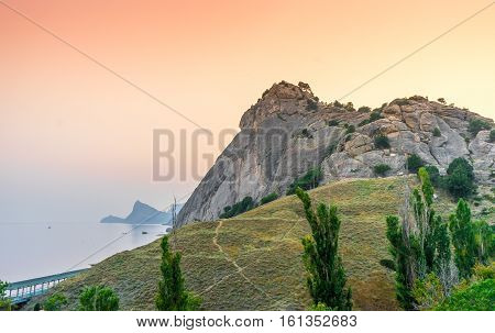 Rocks on the seashore on sunset in Sudak, Crimea
