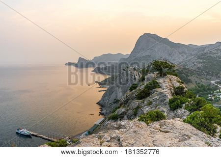 Beautiful seascape view from the old Genoese fortress in Sudak in Crimea at sunset