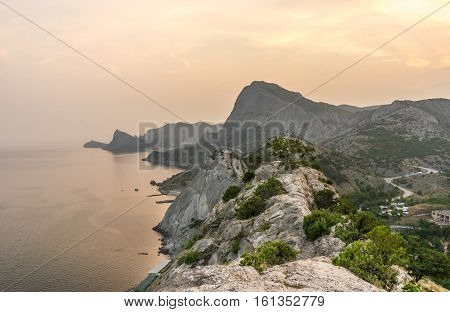 Beautiful mountain and sea landscape from the old Genoese fortress in Sudak in Crimea at sunset