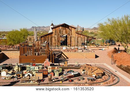APACHE JUNCTION AZ - DECEMBER 8 2016: Superstition Mountain Museum Railroad. The G-Scale Model Train Exhibit with Apacheland Barn and Chapel in the background.