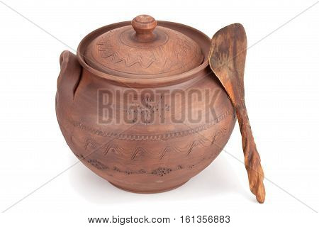 Clay pot wooden spoon isolated on a white background.