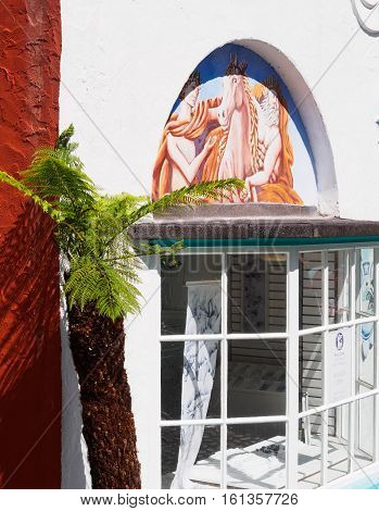Palm and shop front detail of Lady's Lodge Portmeirion Wales