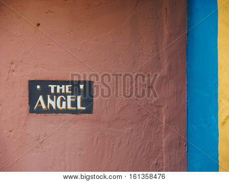Angel name sign and colourful walls at Portmeirion Gwyned Wales.